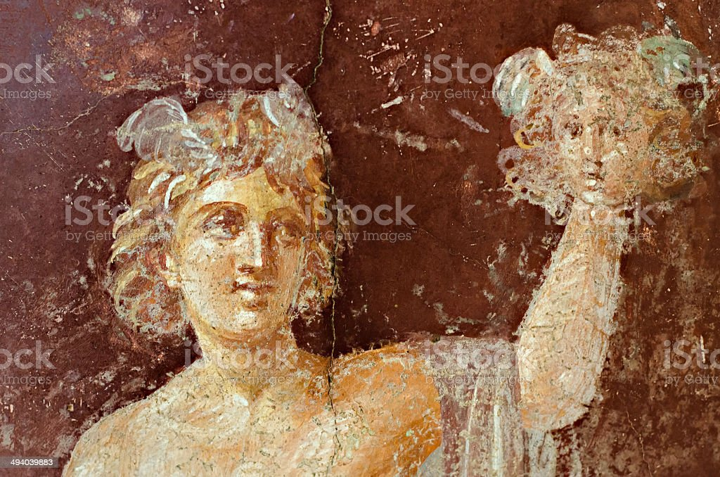 Fresco in Pompeii with Mercury on a red background stock photo