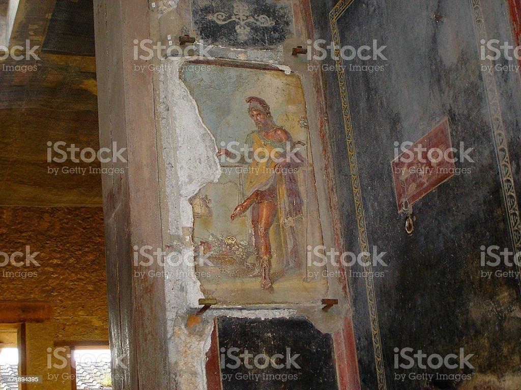 fresco of the roman god Priapo in Pompeii royalty-free stock photo