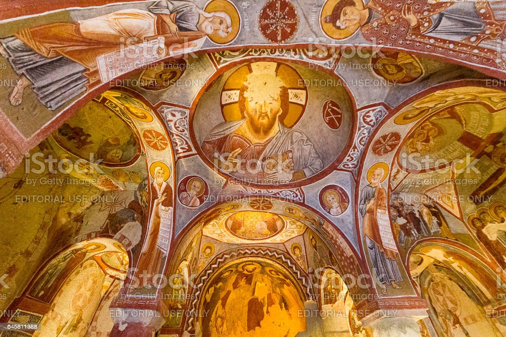 Cappadocia, Turkey - May 18, 2014: Frescos and architecture of the Apple Church in Cappadocia, Turkey. Apple Church is one of the rock cut churches built in the 11th century and its frescos represent biblical scenes. stock photo