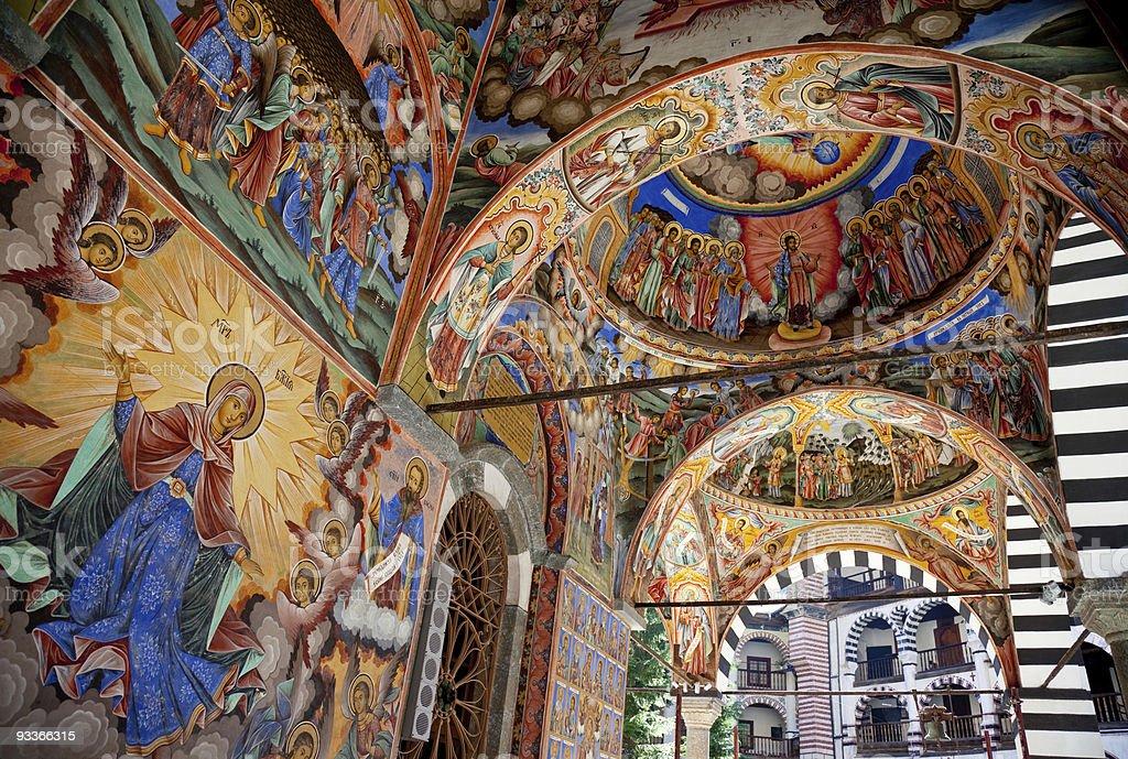 Frescos on Church facade stock photo