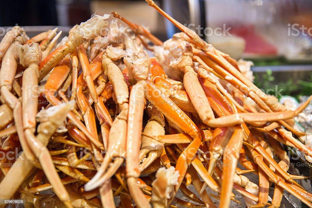 Fresh Alaskan King crab legs in a pile stock photo