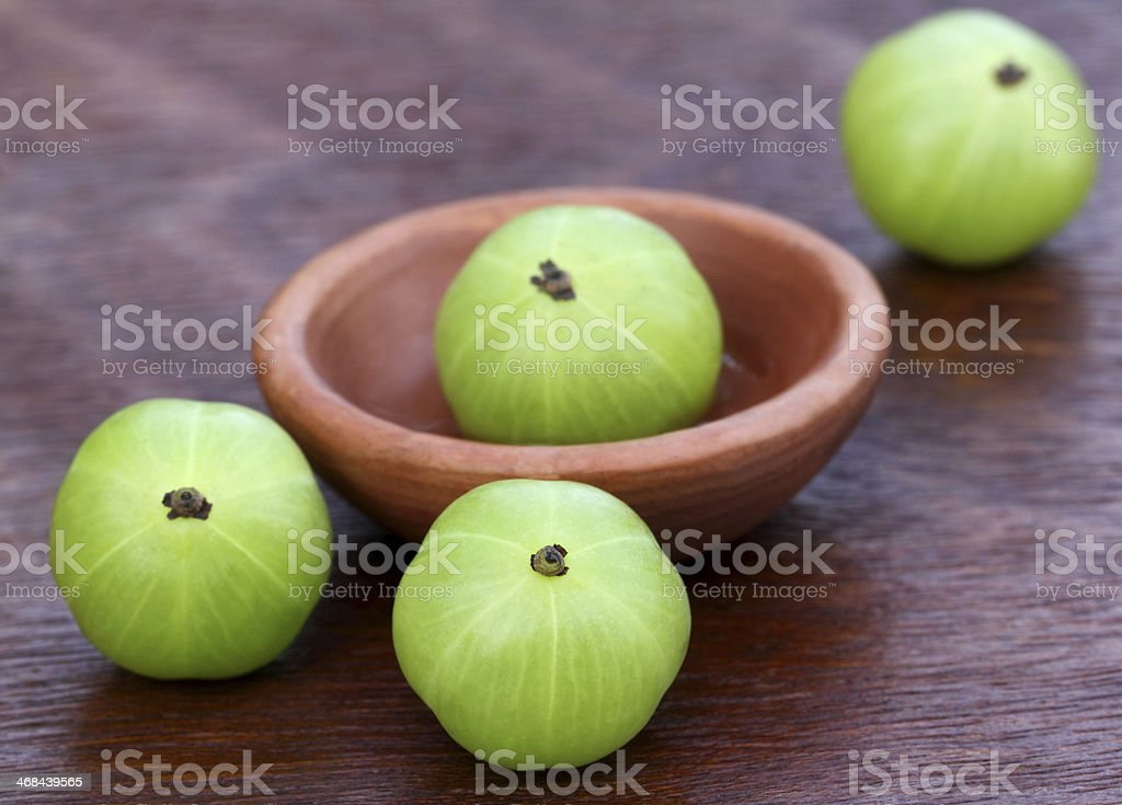 Fresh amla with a small bowl stock photo