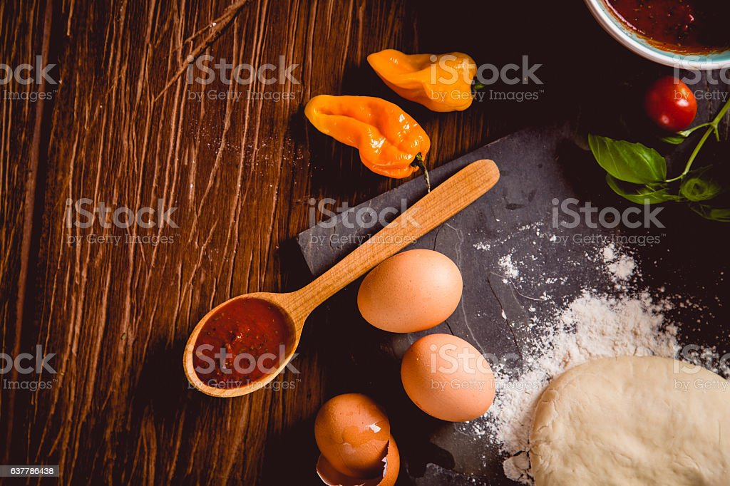 Fresh an tasty homemade pizza preparation stock photo