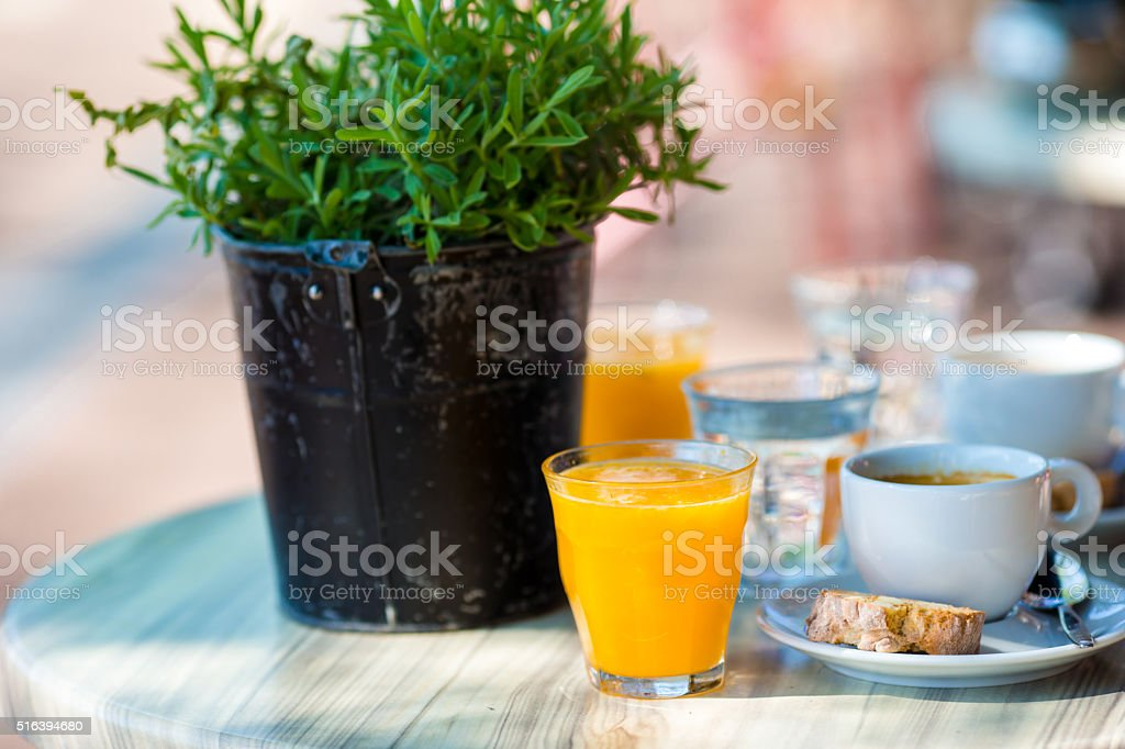 Fresh and delisious breakfast in outdoor cafe at european city stock photo