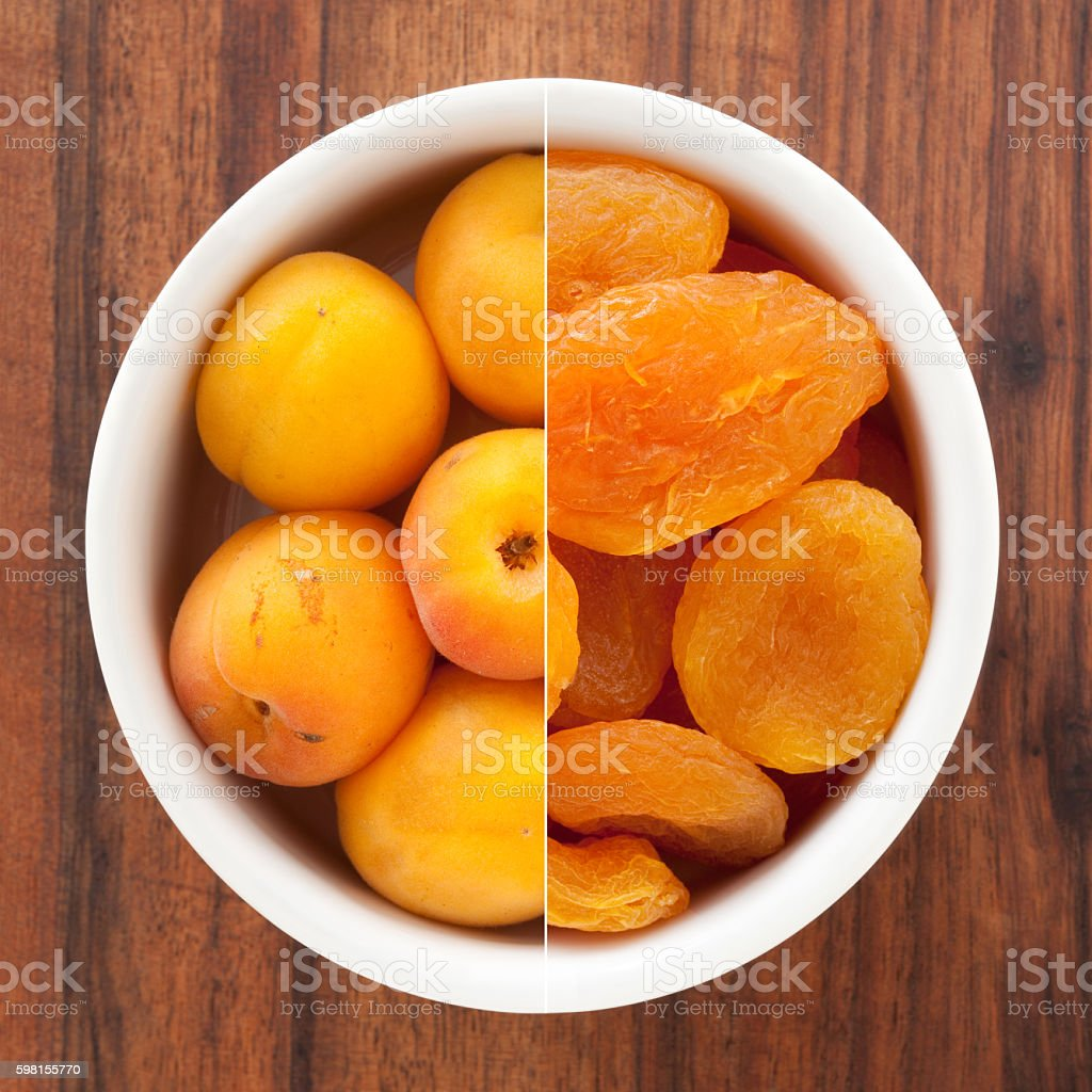 Fresh and dried apricots composition stock photo