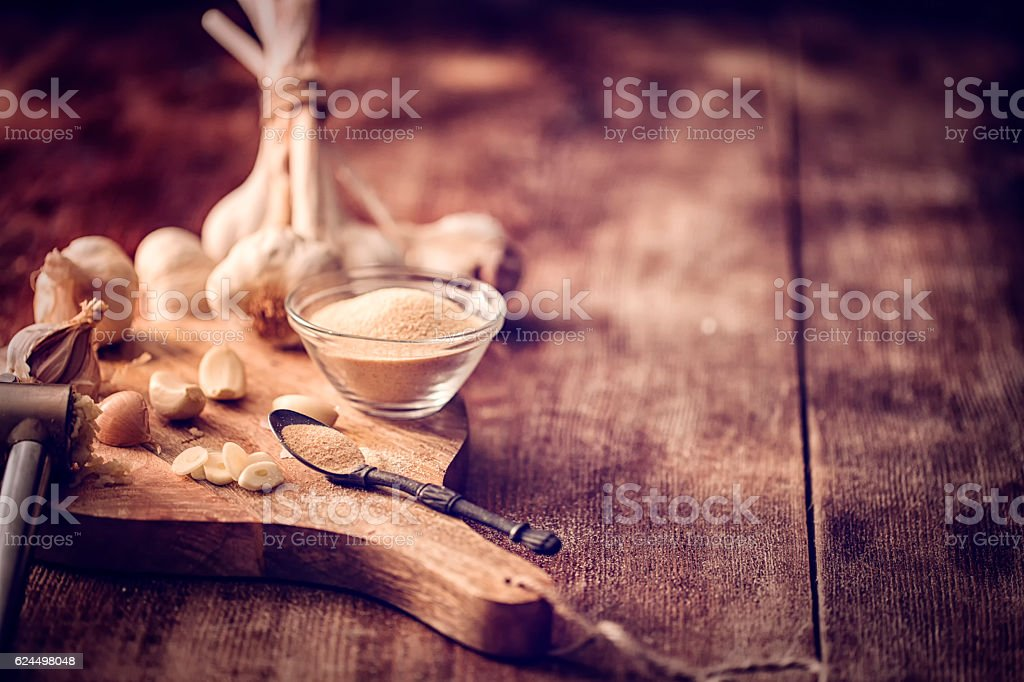 Fresh and Dried Garlic on Wooden Background stock photo