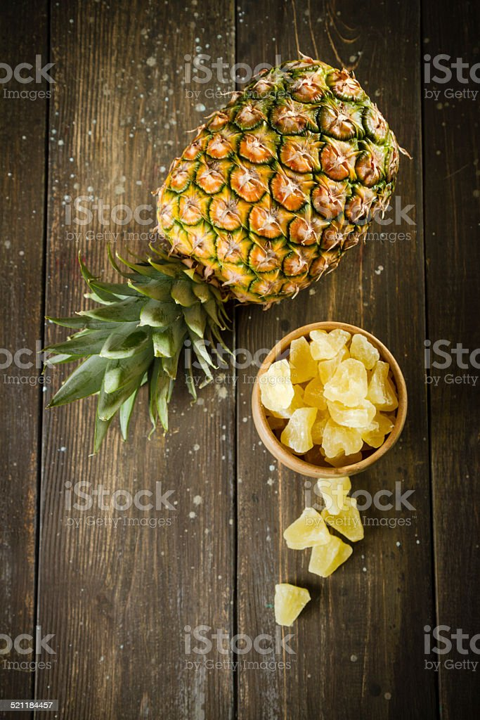 Fresh and Dried Pineapple On Old Wood Table stock photo