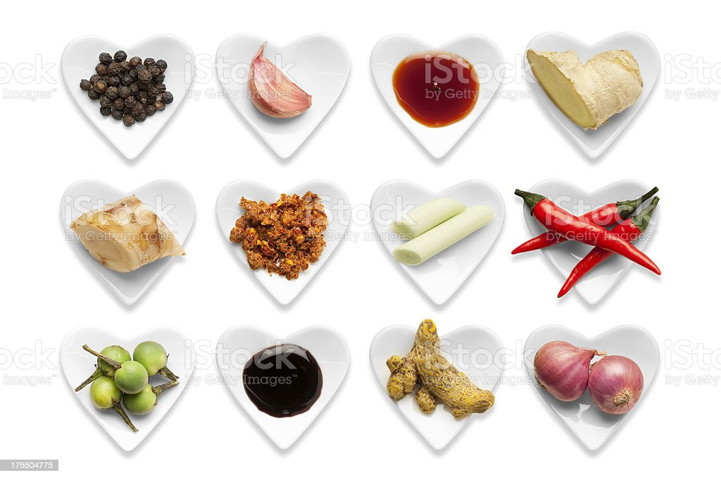 Traditional Thai Ingredients in heart shaped bowls isolated on a...