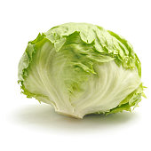 A fresh and green ice-berg lettuce with a white background