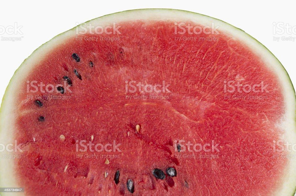 Половина ломтик свежего арбуза, изолированные на белом фоне Стоковые фото Стоковая фотография