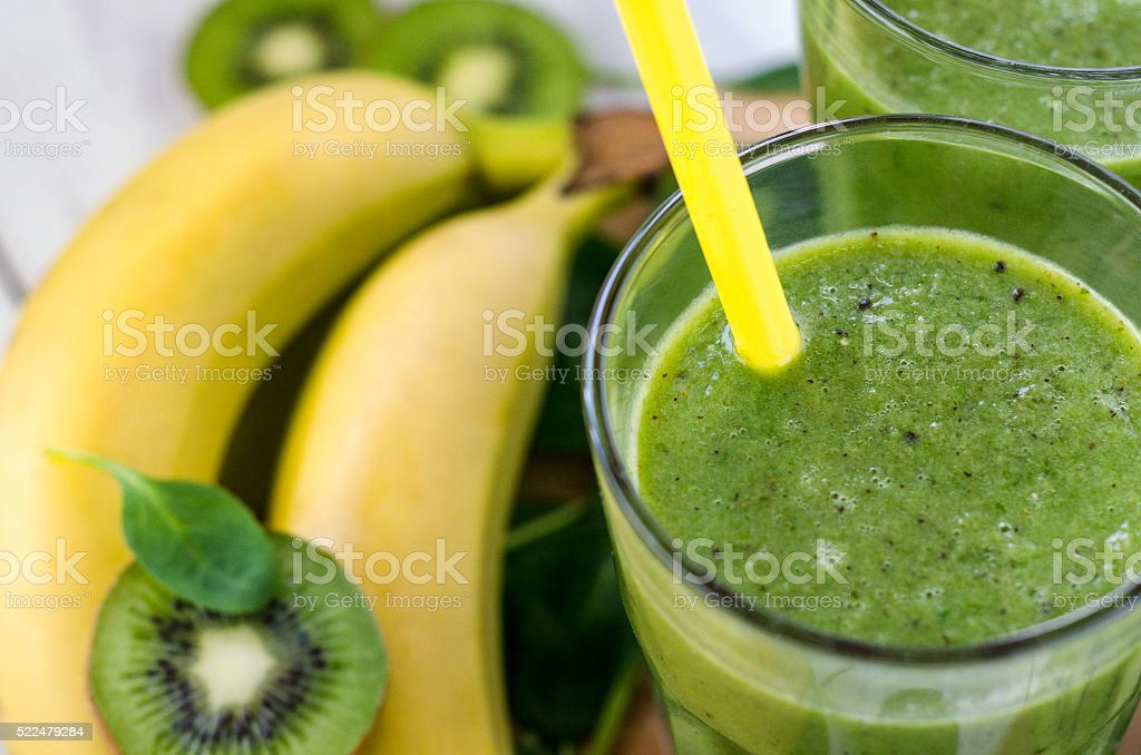 Fresh and healthy green smoothie  with spinach,banana, kiwi stock photo