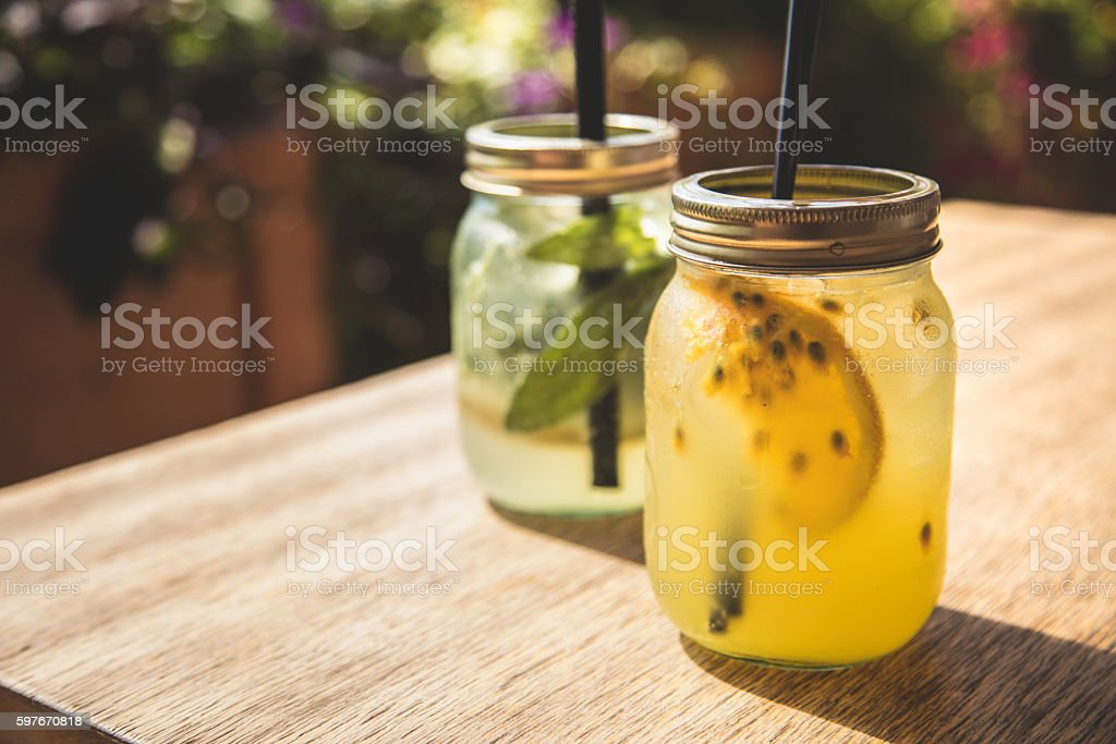 Fresh and juicy lemonade on wooden table stock photo