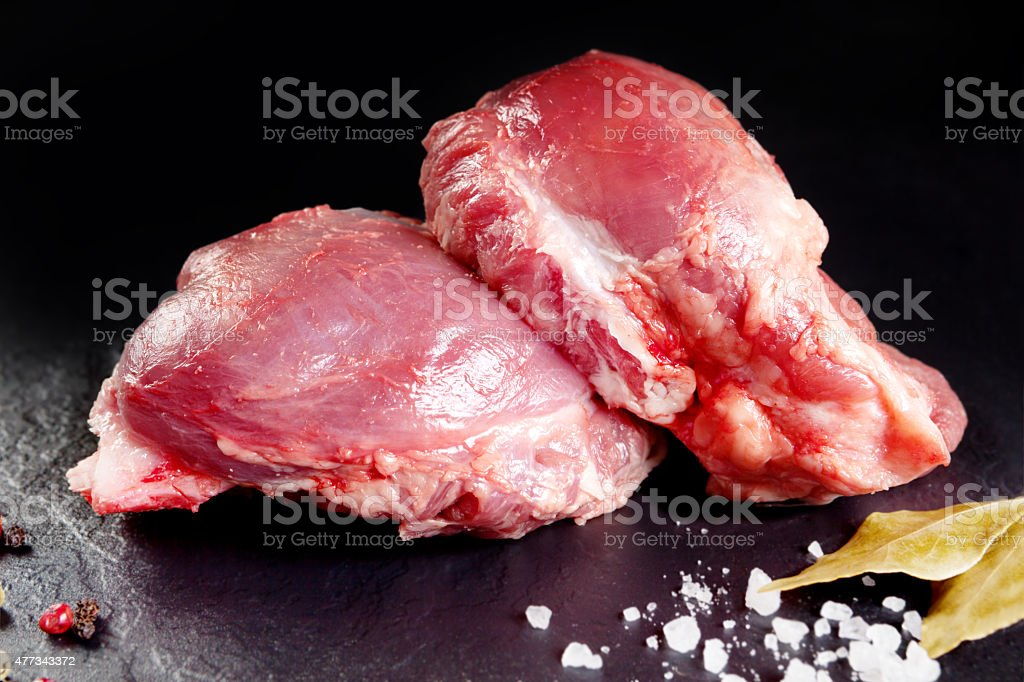 Fresh and raw meat. Cheeks, red pork  grill or barbecue. stock photo
