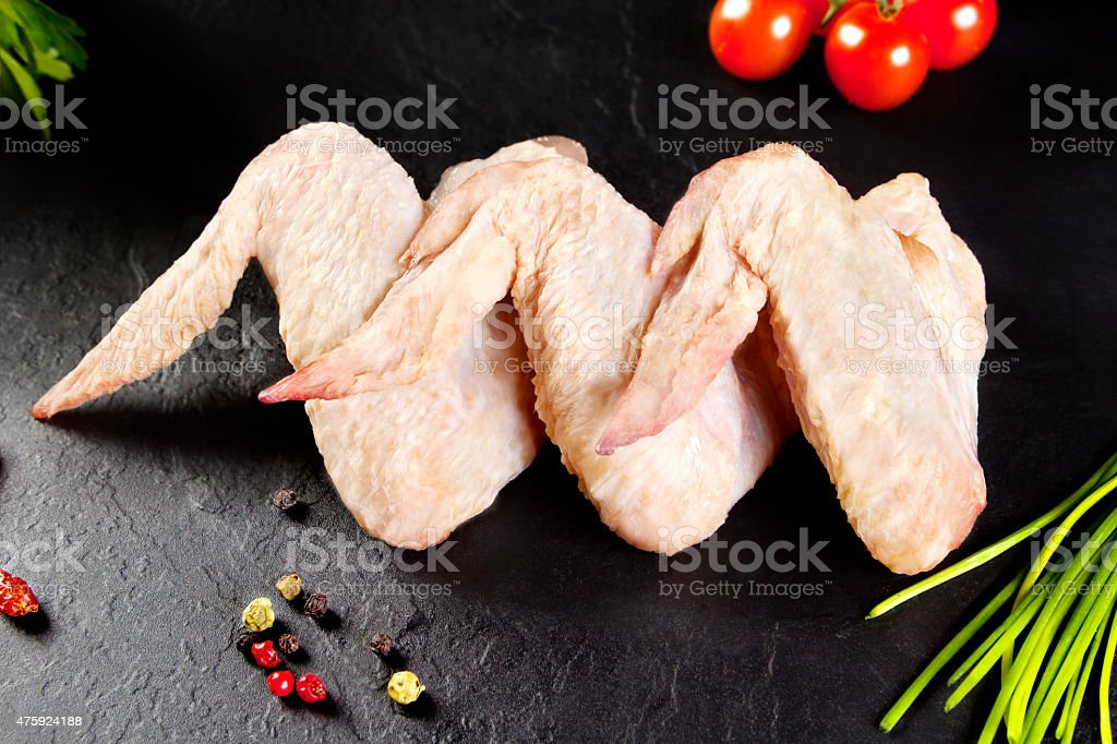 Fresh and raw meat. Chicken wings white  ready to cook. stock photo
