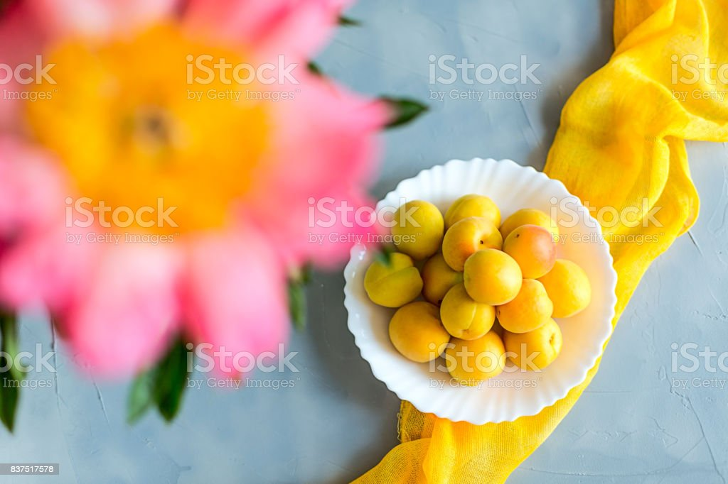 Fresh and ripe apricots on grey background. Season berries, summer food. stock photo
