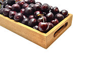 Fresh and sweet cherry in wooden box