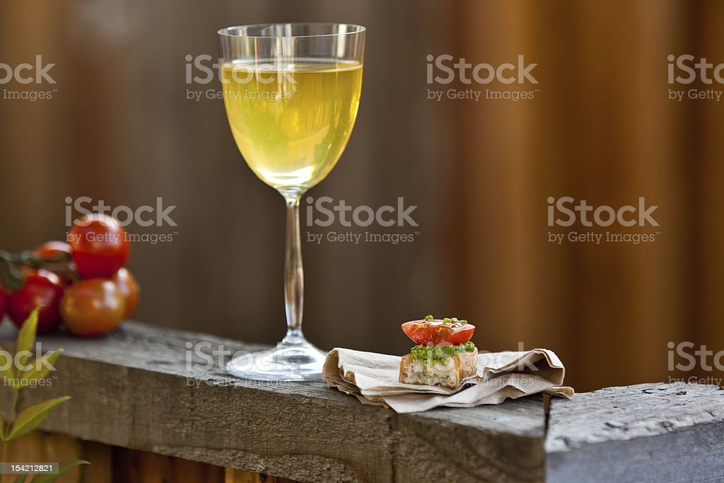 Fresh and tasty pesto bruschetta with wine. royalty-free stock photo