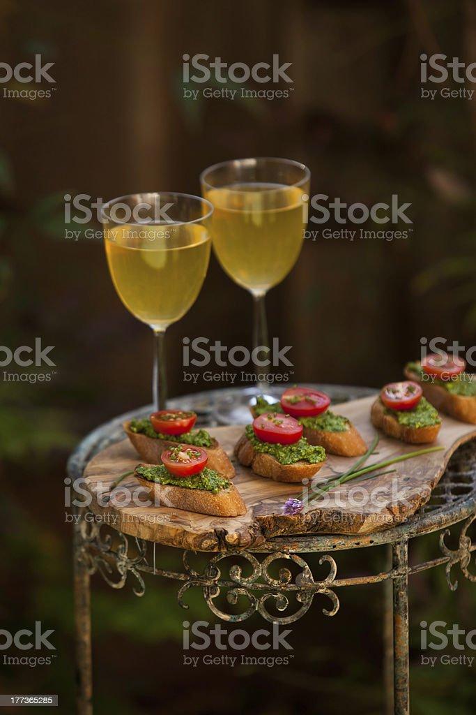 Fresh and tasty pesto bruschetta with wine royalty-free stock photo