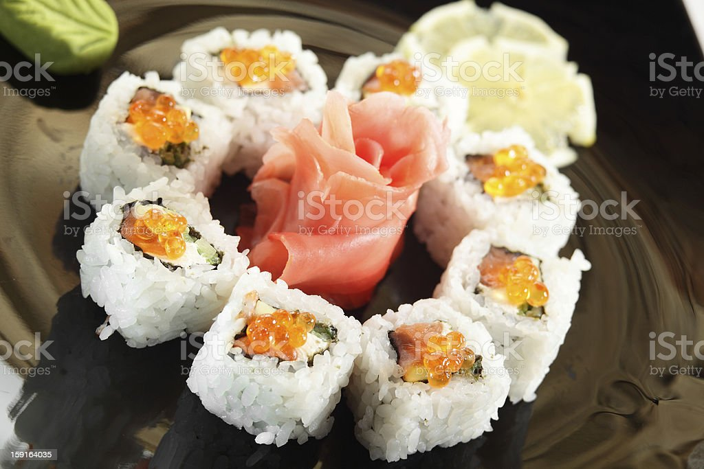 fresh and tasty sushi in black dish royalty-free stock photo