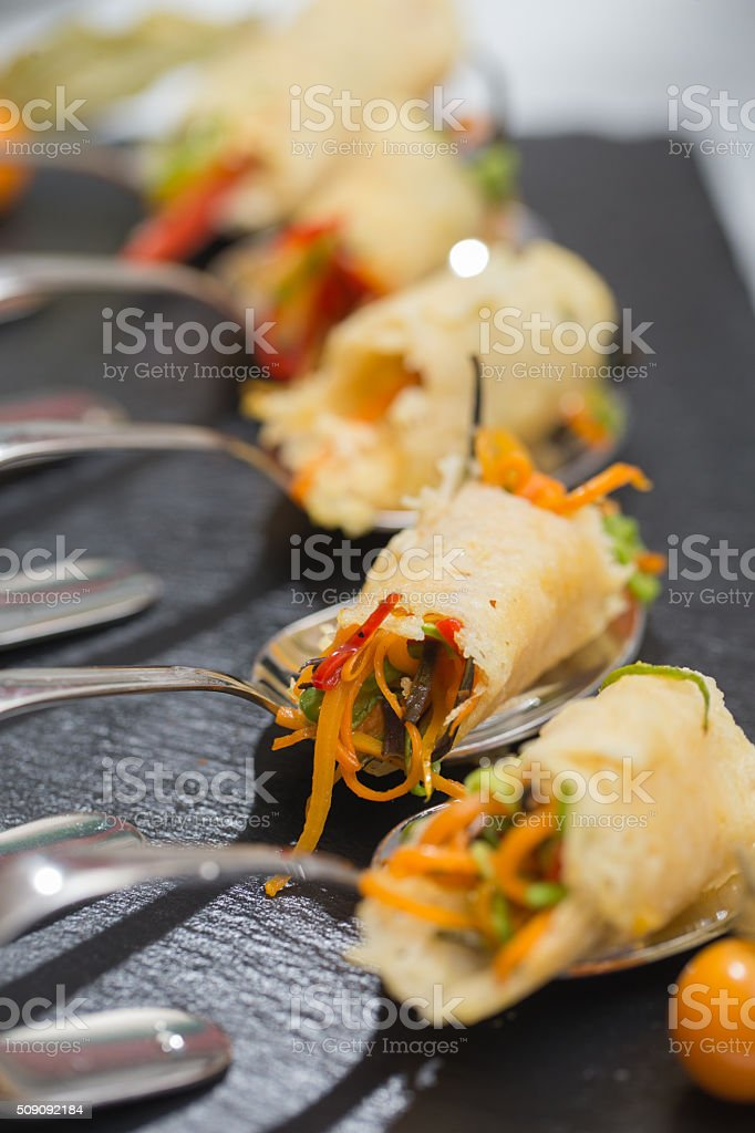 fresh appetizers on spoon stock photo