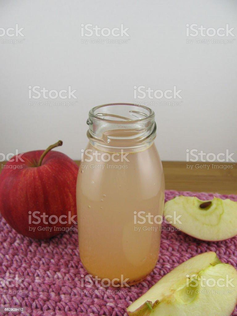 Fresh apple juice in a bottle stock photo