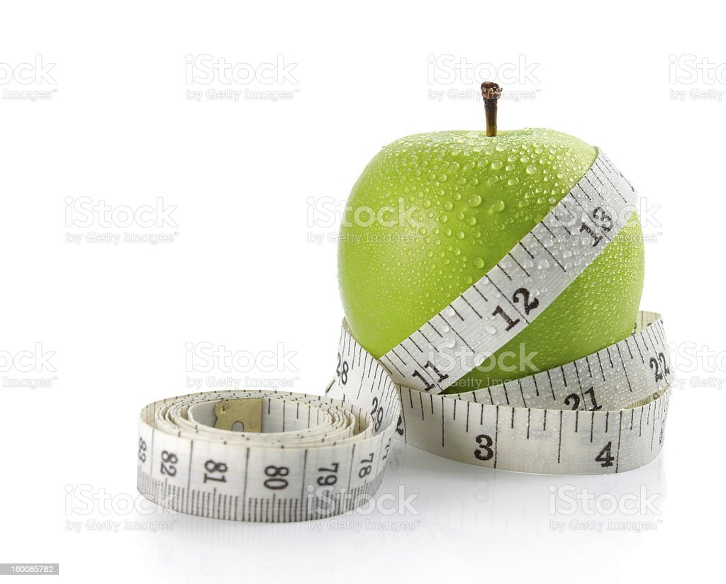 fresh apple with measuring tape stock photo