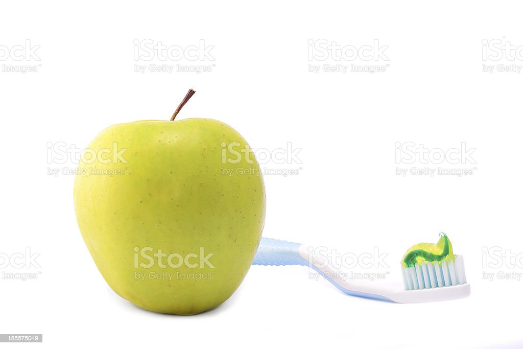 Fresh apple with toothbrush isolated on white royalty-free stock photo