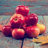 Fresh apples and autumn maple leaf.