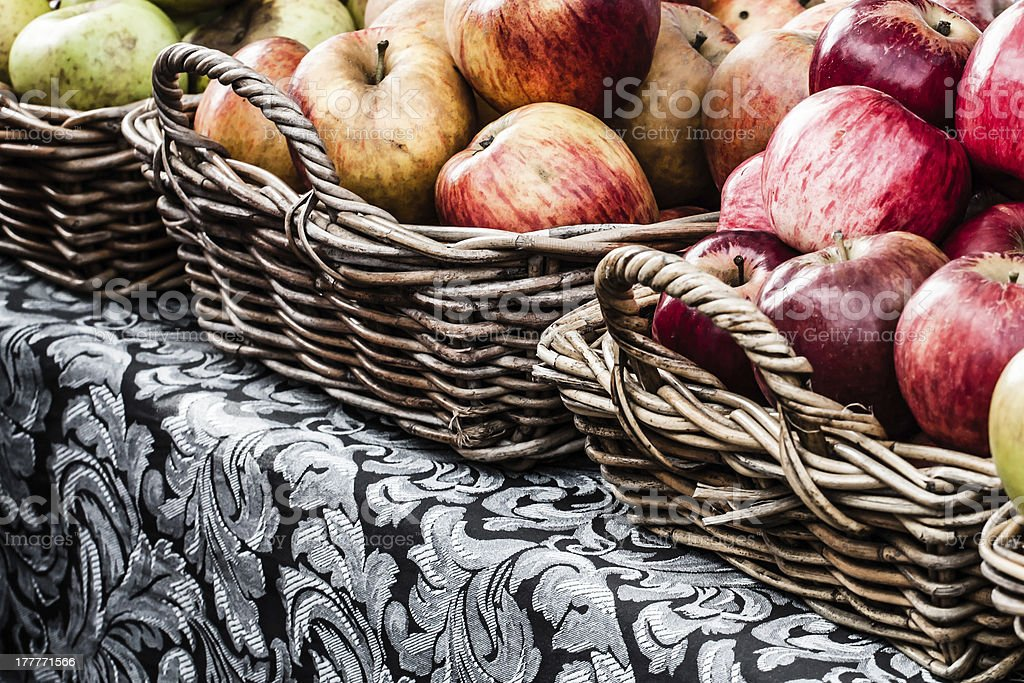 Fresh apples in baskets on display at a farmer's market stock photo