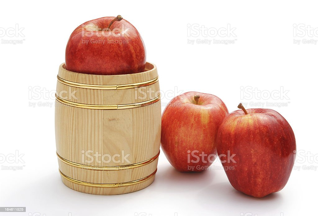 fresh apples in wooden barrel on white with clipping path royalty-free stock photo