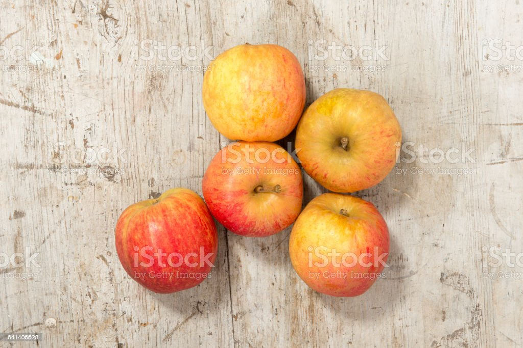 Fresh Apples on a Wooden Background stock photo