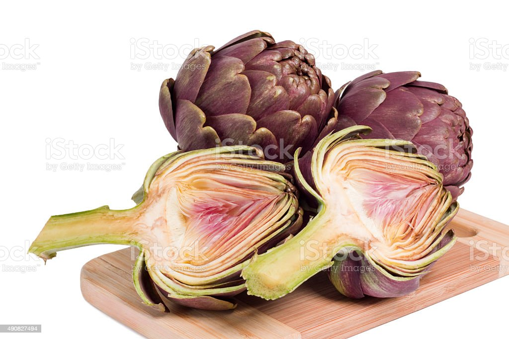Fresh artichokes on a cutting board stock photo