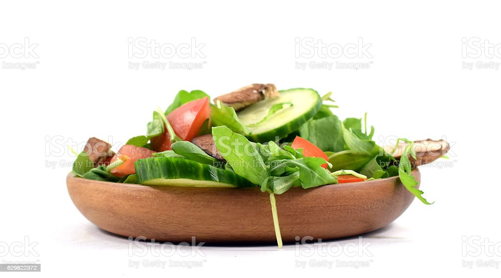 Fresh arugula salad on plate stock photo