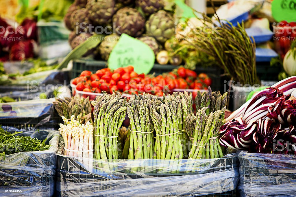 Fresh asparagus and other vegetable on marketplace royalty-free stock photo