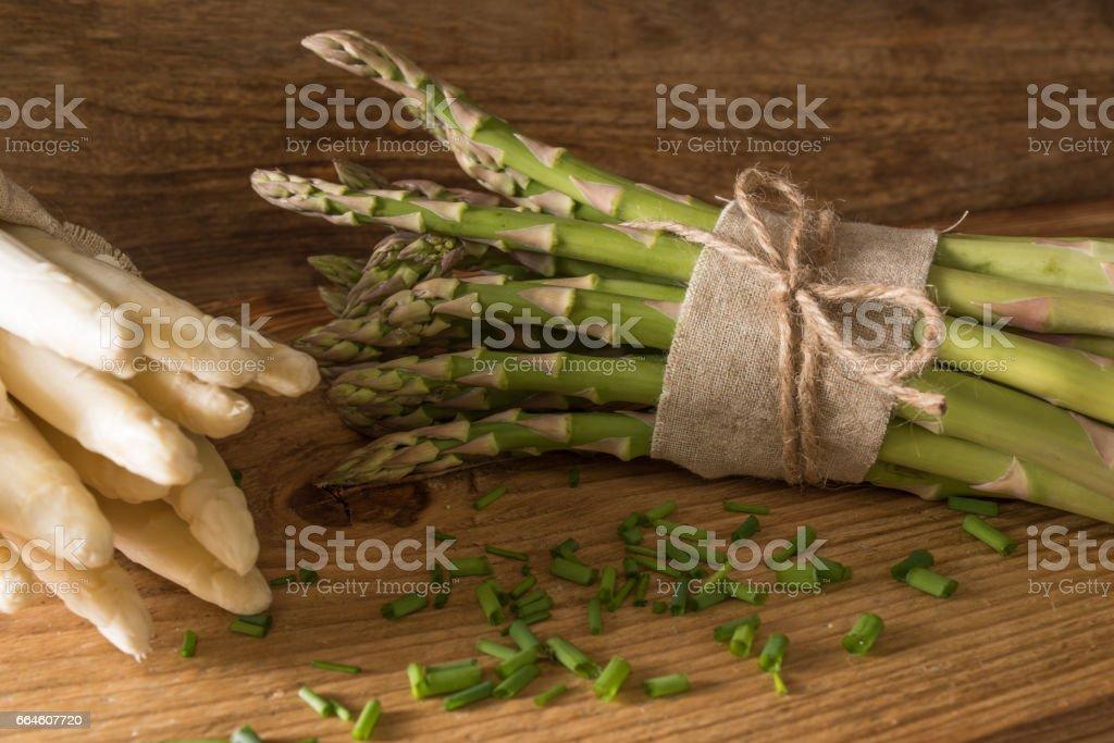 Fresh asparagus on rustic wood stock photo