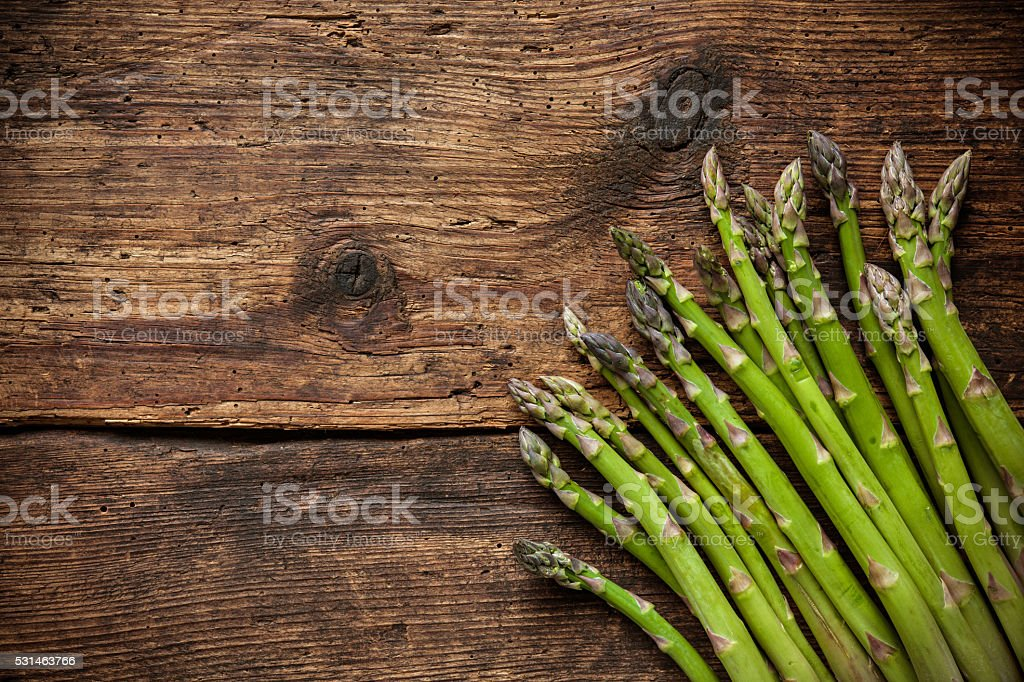 Fresh asparagus on wooden background stock photo
