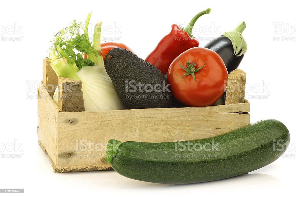 fresh assorted vegetables in a wooden crate royalty-free stock photo