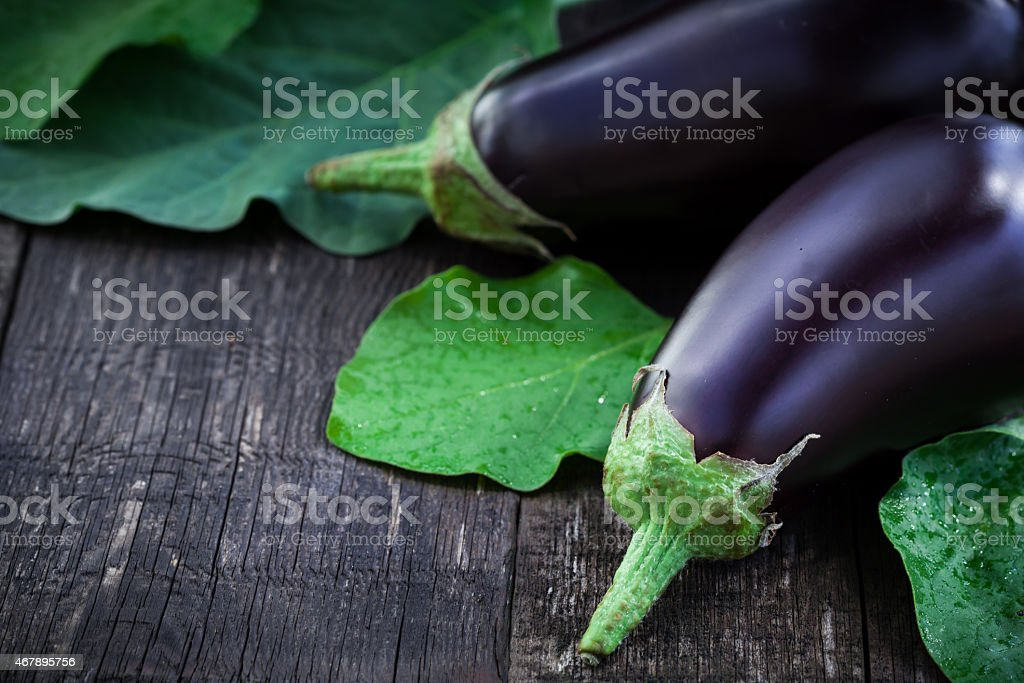 Fresh aubergine on vintage wood background stock photo