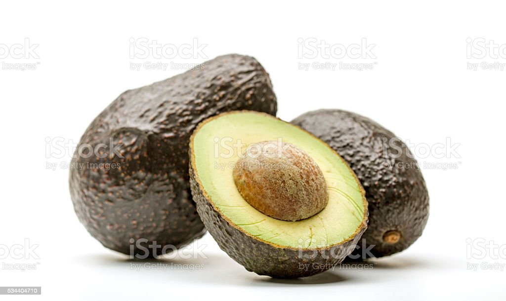 Fresh avocado berries with seed on white background stock photo