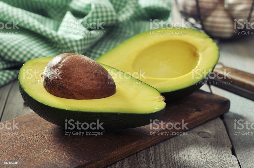 Fresh avocado on cutting board stock photo