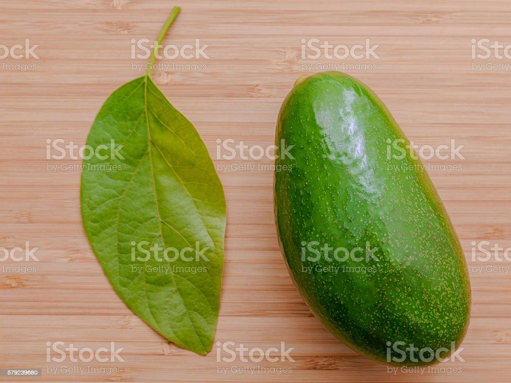 Fresh avocado on wooden background. Organic avocado healthy food stock photo