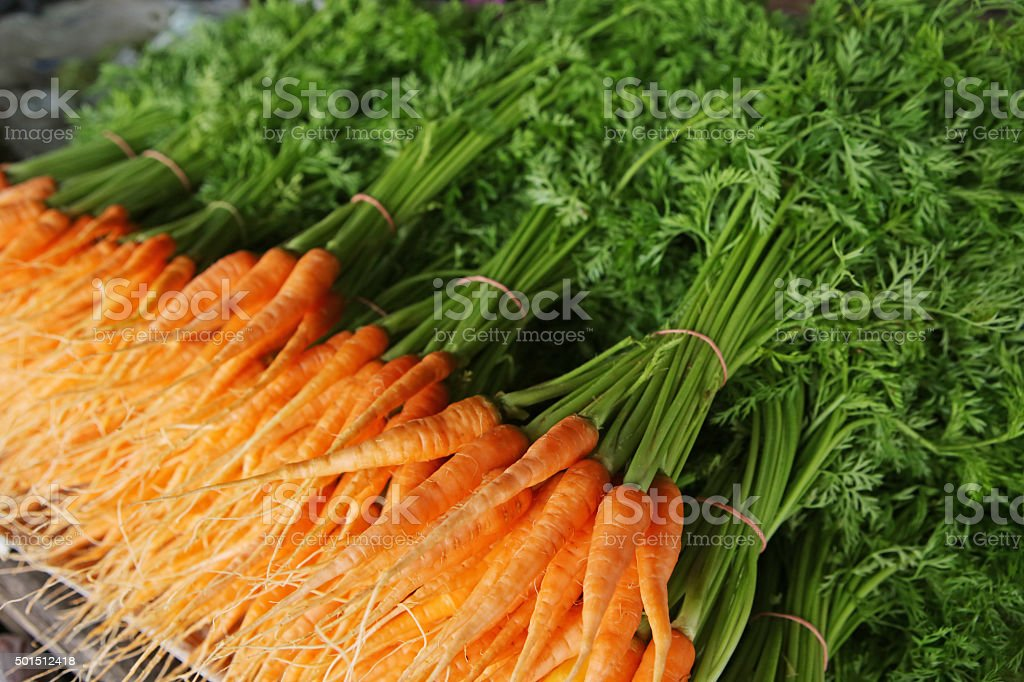 Fresh baby carrots Background stock photo