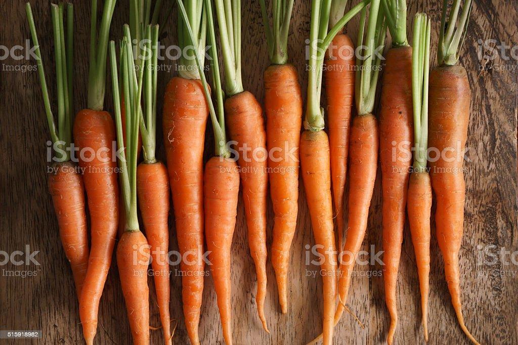 fresh baby carrots stock photo