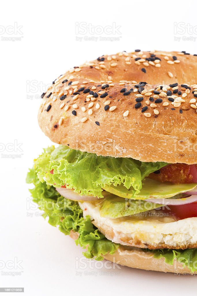 Fresh bagel sandwich isolated over white background royalty-free stock photo