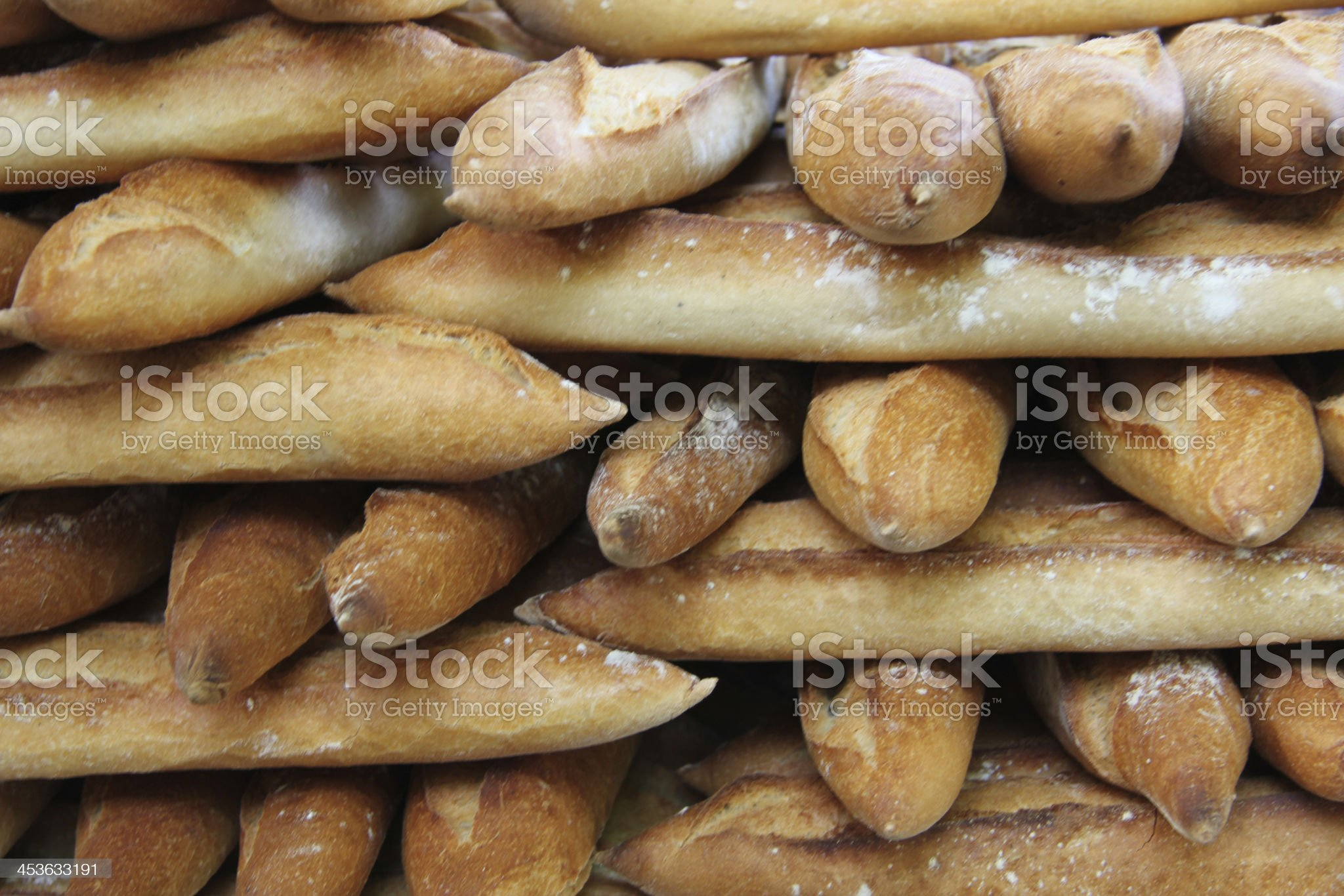 Fresh baguettes at a market royalty-free stock photo