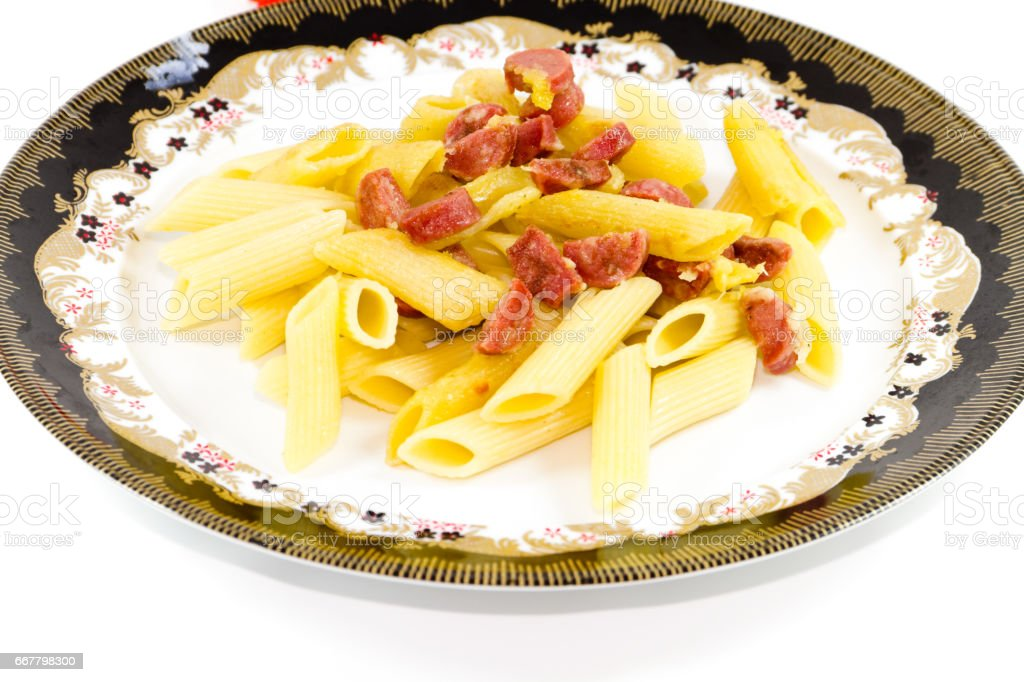 Fresh Baked and Roasted Noodles with Sausages and Cheese stock photo