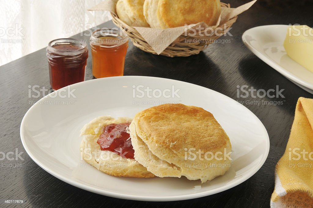 Fresh baked biscuit with jam stock photo