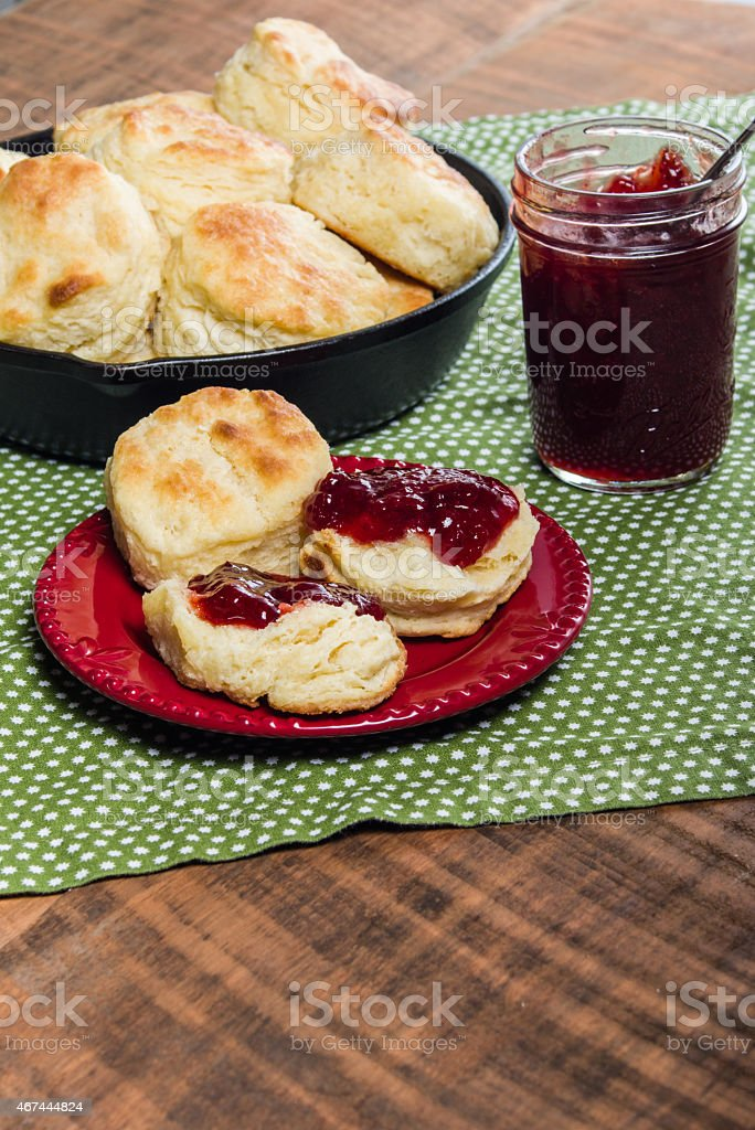 Fresh baked biscuits and jam or preserves stock photo