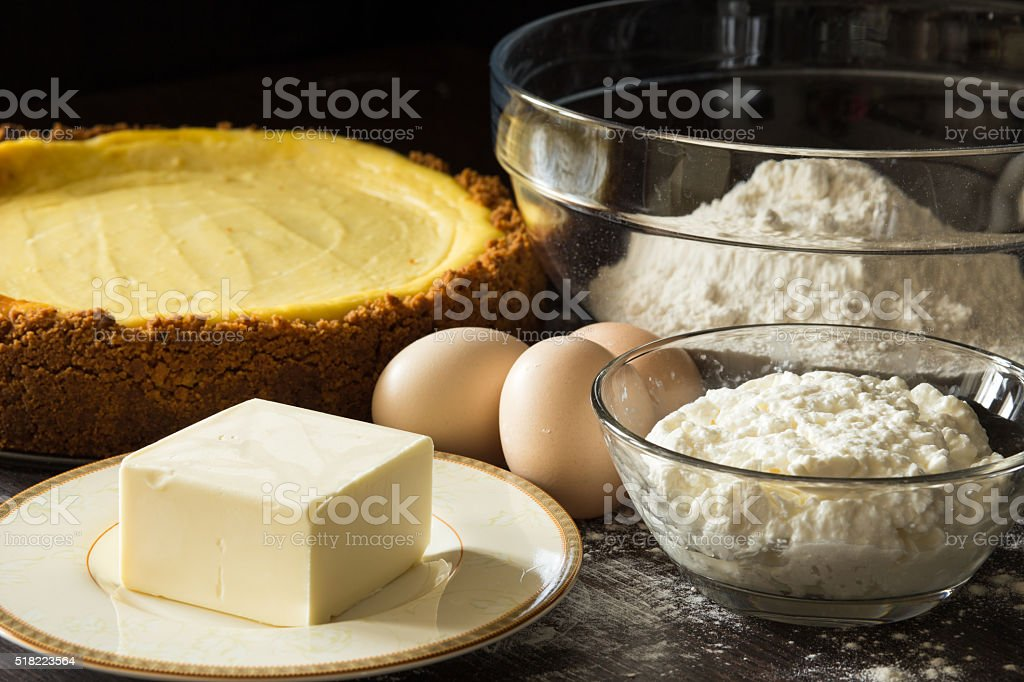 Fresh baked cake with butter flour and eggs around stock photo