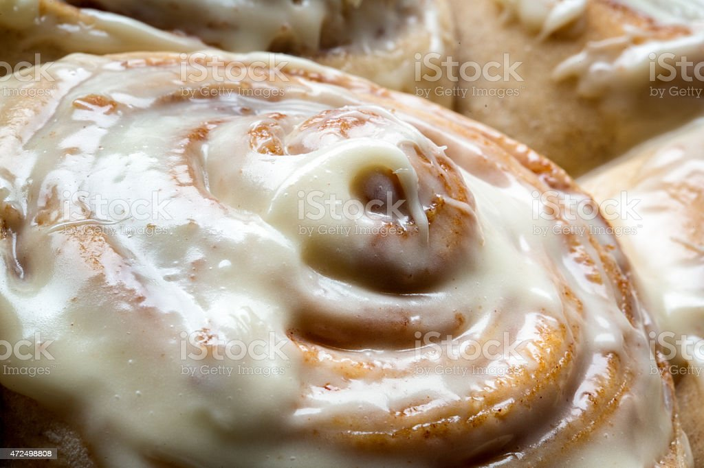 Fresh Baked Cinnamon rolls with creamy frosting stock photo
